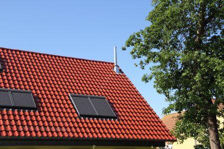 Photo pour A house with new roof window - image libre de droit