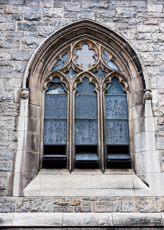 An old church window showing much detail and texture