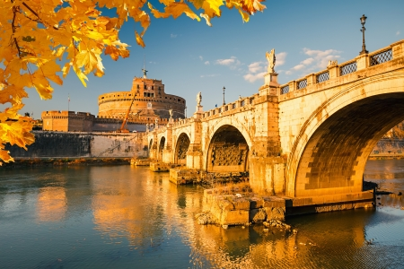 Saint Angelo and bridge over the Tiber river in Rome