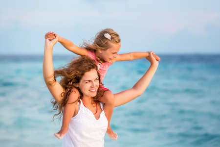 Foto per Happy mother and daughter on the ocean beach on Maldives at summer vacation - Immagine Royalty Free