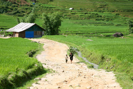 Stock Photo: SAPA, VIETNAM- JULY 7: Unidentified woman and child of the Black H'Mong Ehtnic Minority in the hills of Sapa, Vietnam on July 7, 2007. H'mong are the 8th largest ethnic group in Vietnam