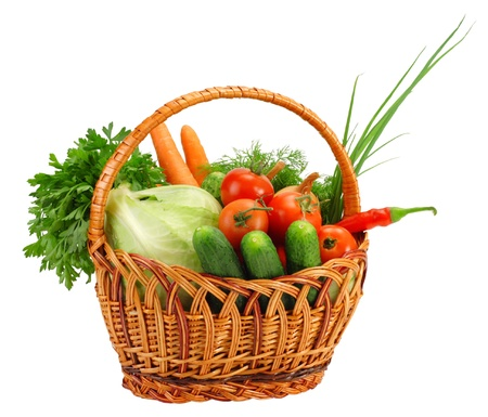 Basket with vegetables, isolated on whiteの写真素材