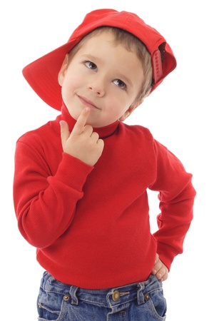 Photo pour Smiling little boy in red hat thinking about, isolated on white - image libre de droit