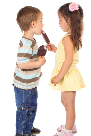 Little boy eating girl's chocolate ice cream