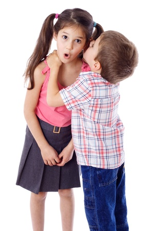 Photo pour Little boy whispering something to surprised girl, isolated on white - image libre de droit