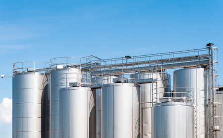 Stainless steel silos . For a milk processing plant.