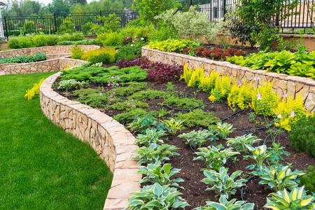 Photo pour Natural stone landscaping in home garden - image libre de droit
