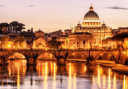 Night view Sant'Angelo and San Pietro (St. Peter's cathedral) in Rome, Italy