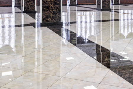Photo pour Marble floor in the luxury lobby of office or hotel. Real floor tile pattern with reflections for background. Shiny floor after professional cleaning. - image libre de droit