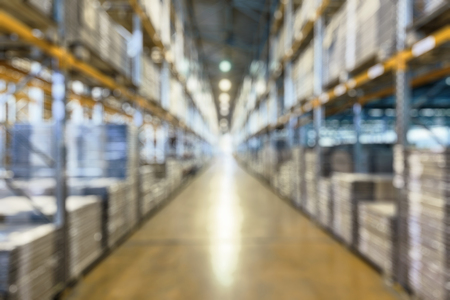 Foto für Warehouse as creative abstract blur background. Logistics and transportation concept. Panoramic view of warehouse interior. Industrial storage and stock. Goods are inside the large modern warehouse. - Lizenzfreies Bild