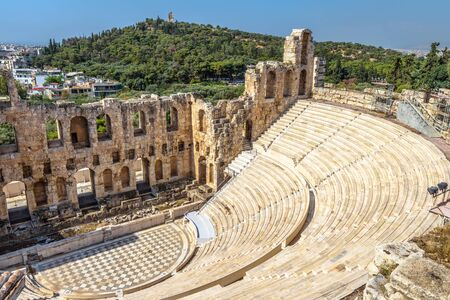 Photo for Odeon of Herodes Atticus at Acropolis, Athens, Greece. It is one of the main landmarks of Athens. Antique amphitheater close-up. Scenic view of famous Ancient Greek ruins in the Athens center. - Royalty Free Image