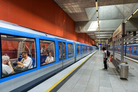 Photo for Munich, Germany - Aug 2, 2019: Inside the metro station in Munich. Train with passengers in modern subway. Panoramic view of platform of urban underground. Concept of city transport in Europe. - Royalty Free Image