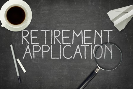 Retirement application concept on blackboard with magnifyng glass