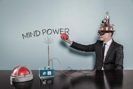 Photo pour Mind power concept with businessman holding brain at hand in office - image libre de droit