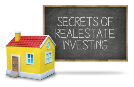 Secrets of real estate investing text on blackboard with 3d house front of blackboard on white background