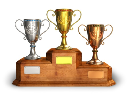 Gold, silver and bronze trophy cups on wooden pedestal isolated on white background