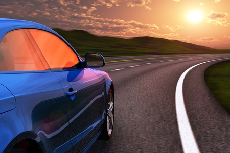 Blue car driving by autobahn in sunset with motion blur effect