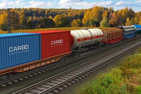 Scenic view of mixed freight train within rural landscape