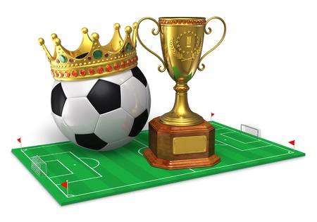 Football championship concept  golden trophy cup and soccer ball with crown on green soccer field isolated on white background