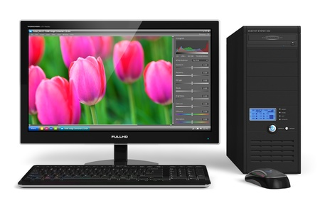 Desktop computer with photo editing software on screen