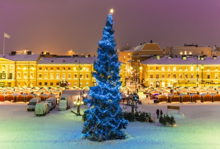 Winter night scenery of Senate Square with Christmas Tree and holiday market in Helsinki, Finland
