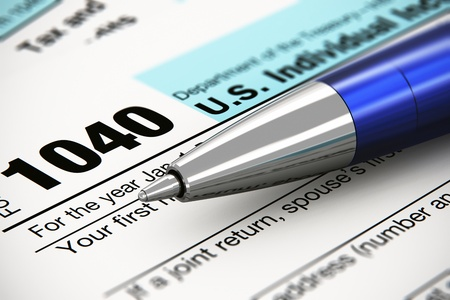 Tax form business financial concept  macro view of individual return tax form and blue metal ballpoint pen
