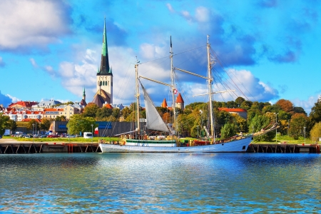 Scenic summer panorama of pier with historical tall sailing ship in the Old Town in Tallinn