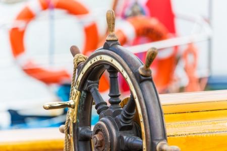 Macro view of wooden steering wheel on sailing ship