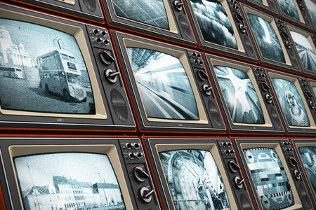 Creative abstract television broadcasting, news media, business, entertainment and cinema concept  wall of old wooden black and white TV screens with various broadcast channels