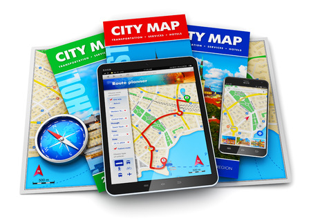 Creative abstract GPS satellite navigation, travel, tourism and location route planning business concept: set of color city maps, magnetic compass, modern black glossy touchscreen tablet computer PC and smartphone or mobile phone with wireless navigator m