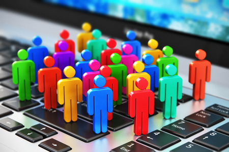 Photo pour Creative abstract social media internet communication and business marketing corporate web concept: macro view of group of 3D color people figures on laptop or notebook keyboard with selective focus effect - image libre de droit