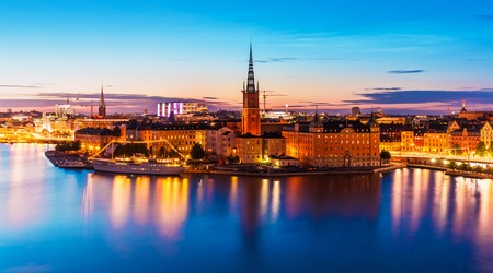 Scenic summer night panorama of the Old Town Gamla Stan architecture pier in Stockholm, Sweden