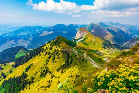 Foto de Scenic summer panorama from Rochers de Naye mountain peak with green grassy hills and flower meadows in Alps, Switzerland - Imagen libre de derechos