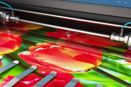Foto de 3D render illustration of printing photo banner on large format color plotter in typography or print house printshop - Imagen libre de derechos