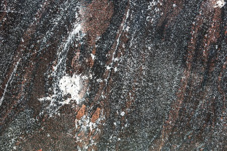 Black marble slab as an abstract background .