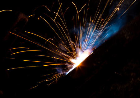Foto für Sparks from welding at a construction site as a background. - Lizenzfreies Bild