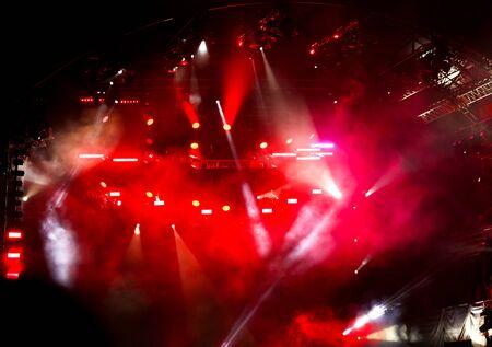 Photo pour Red light on a rock concert stage as background. - image libre de droit