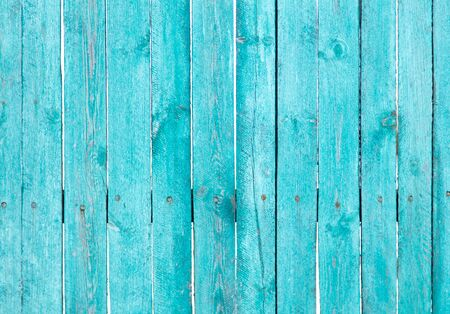Photo pour Wooden boards on an old blue fence as an abstract background. Texture. - image libre de droit
