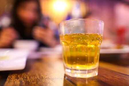Photo pour A glass glass with a drink stands on a table in a bar. - image libre de droit