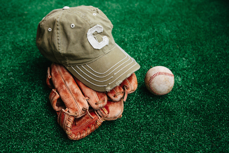 Baseball cap of captain, ball and leather catcher\'s glove
