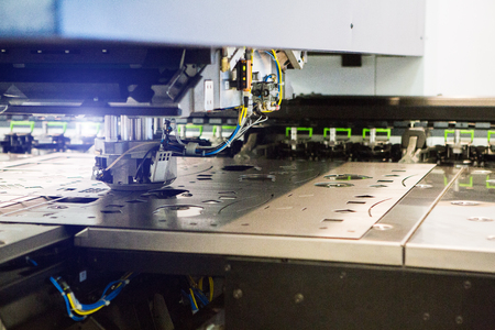 Foto per Robot for stamping metal products during work. Modern automated factory - Immagine Royalty Free