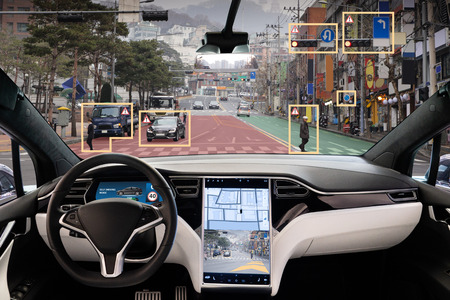 Foto de Autonomous car with HUD (Head Up Display). Self-driving vehicle on city street - Imagen libre de derechos