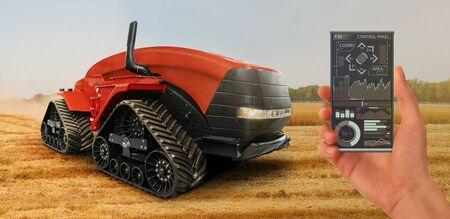 Foto für Farmer controls an autonomous tractor - Lizenzfreies Bild