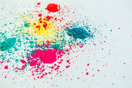 Photo pour Abstract multicolor powder mixed on white background. Freeze motion of color powder. Concept Indian festival Holi. - image libre de droit