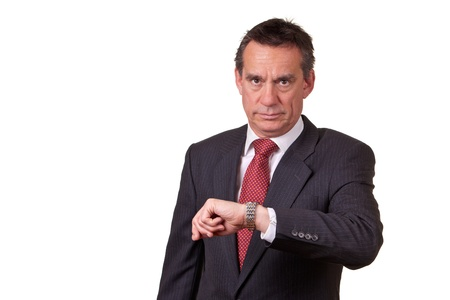 Frowning Angry Business Man Looking at Time on Watch