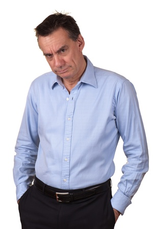 Angry Middle Age Man in Blue Shirt with Grumpy Expression and Hands in Pockets