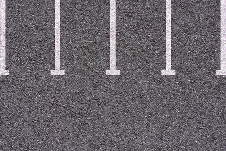 Parking lot - white lines on asphalt background texture