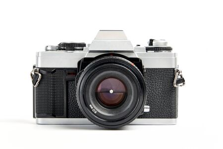 Photo for front view of a Classic analog 35 mm camera vintage and analog film rolls on white background - Royalty Free Image