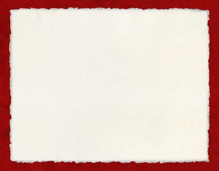 Watercolor paper with true deckled edges on a red background.  File includes a clipping path.