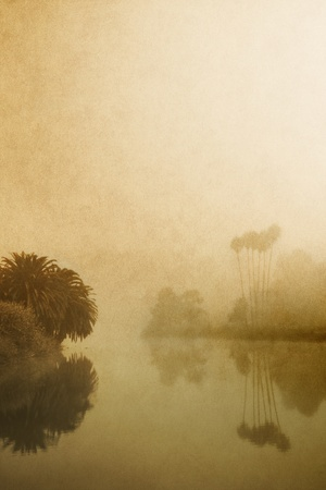 An estuary in fog with a vintage look and paper textures.